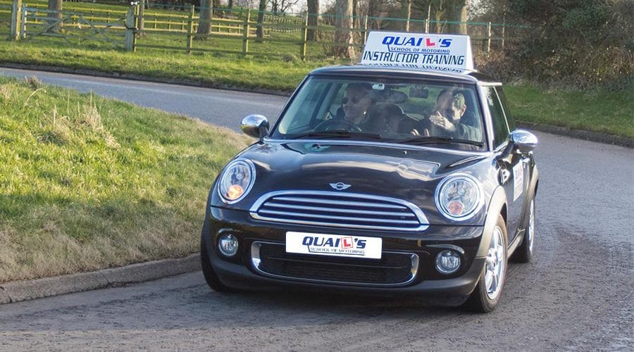 Local driving lessons - mini black car instruction